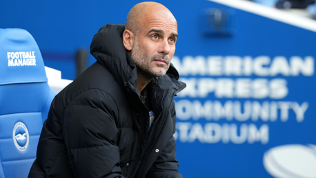 THE BOSS: Guardiola looks on from the dugout.