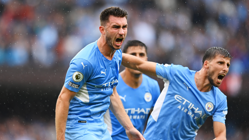 PASSION : Aymeric Laporte roars as he scores City's third of the afternoon.