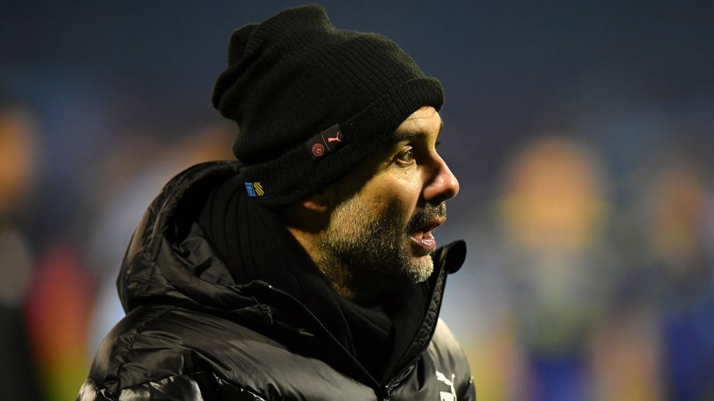 MATCH MODE : Pep Guardiola watches on from the sideline.