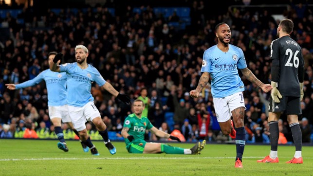 STRIKE ONE : Raheem Sterling is all smiles after netting the Blues' first goal