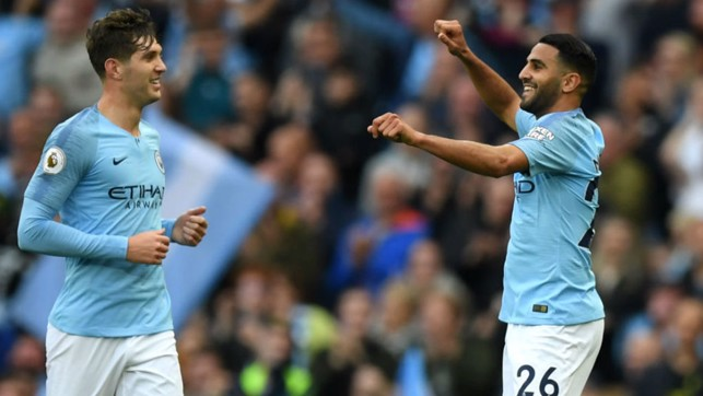 ALL SMILES : Riyad Mahrez celebrates with John Stones after his stunning strike
