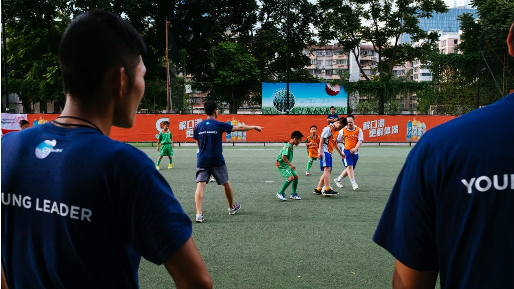 HELPING HAND : Young leaders hard at work in Guangzhou, China