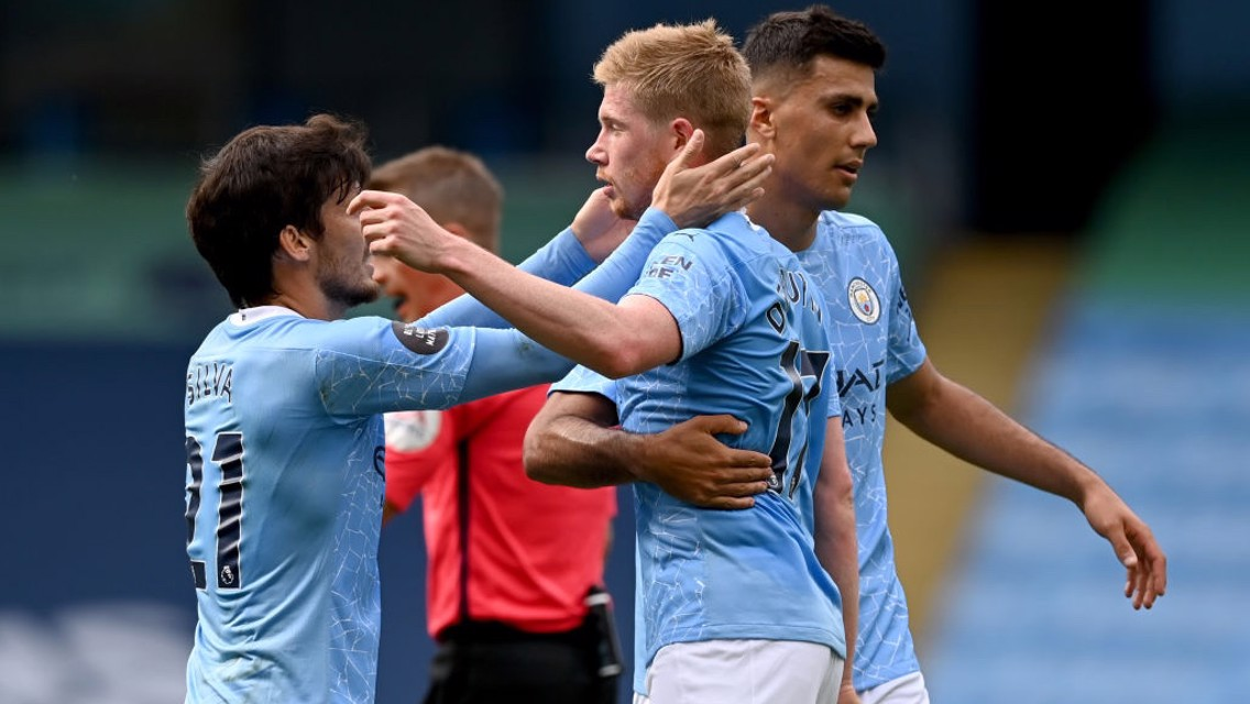 FEELING THE LOVE: Silva and Rodri congratulate KDB after his stunning goal.
