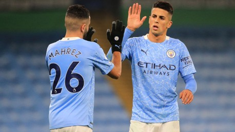 OVER AND OUT: Mahrez and Cancelo celebrate the victory as the referee blows the full-time whistle.
