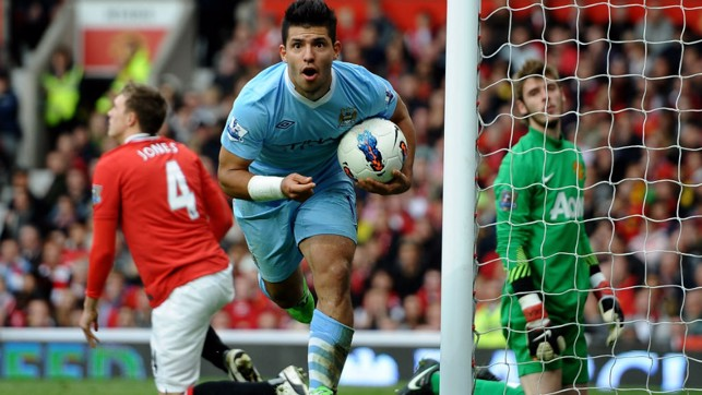 DEMOLITION DERBY : Kun wheels away in delight after netting at Old Trafford in THAT 6-1 victory!