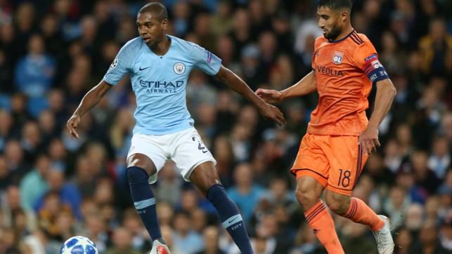 MIDDLE MARCH : Fernandinho takes on Lyon's Nabil Fekir