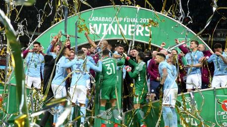 WINNERS: City lift the trophy!