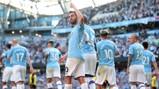 PROUD AS PUNCH: Bernardo acknowledges the City fans