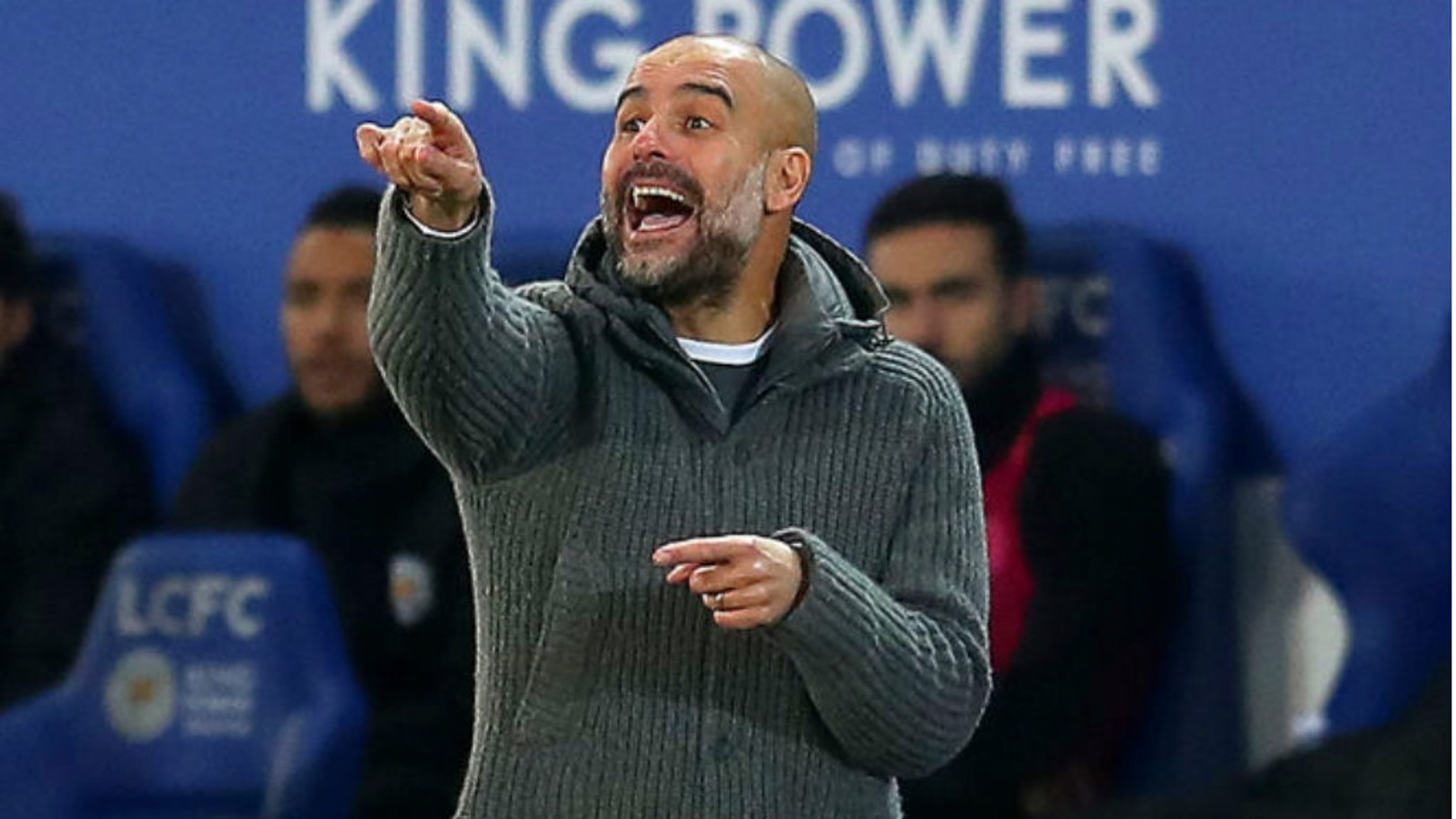 FESTIVE POINTER: Pep Guardiola passes on some intructions
