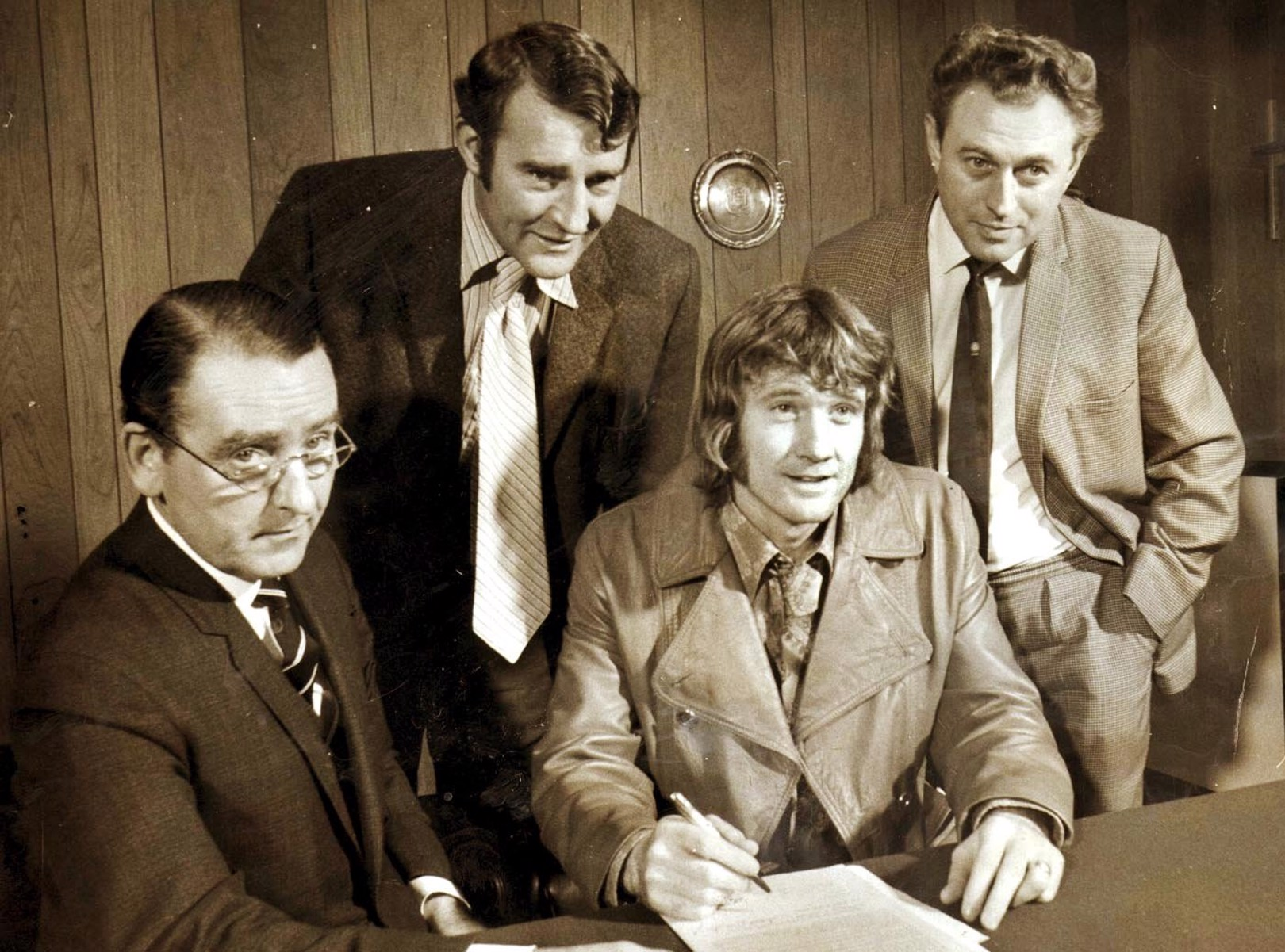 TRUE BLUE: Eric Alexander is pictured (far right) alongside former City secretary Walter Griffiths (left) and manager Malcolm Allison as Rodney Marsh signs for City in 1972