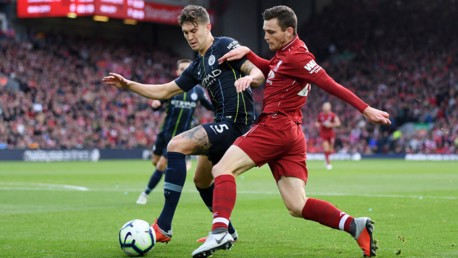 SOLID BLOCK: John Stones puts the squeeze on Andy Robertson