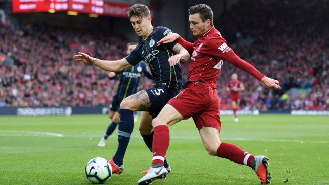 SOLID BLOCK : John Stones puts the squeeze on Andy Robertson