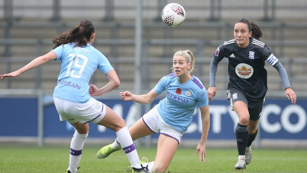 ACTION STATIONS : Caroline Weir and Gemma Bonner combine to clear the danger