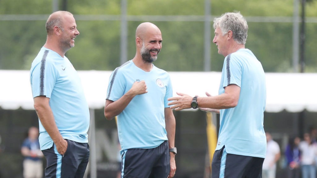 ALL SMILES: Brian shares a light-hearted moment with manager Pep Guardiola and fellow assistant coach Rodolfo Borrell