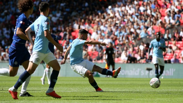 200 UP : Sergio Aguero shoots home against Chelsea at Wembley