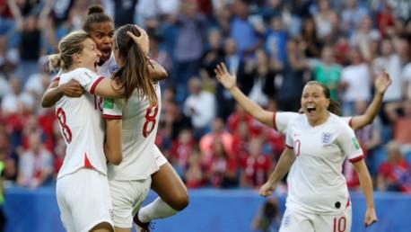 ROAR POWER: Nikita Parris and Ellen White salute Jill Scott after the City midfielder's sensational early strike for England