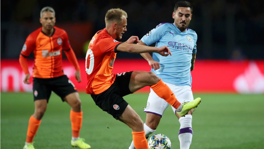 MIDDLES MARCH : Ilkay Gundogan puts the squeeze on the Shakhtar midfield