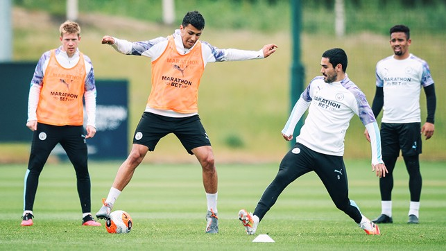 Balancing act:  : Rodri takes on Ilkay...