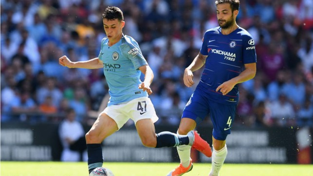 MIDDLE MARCH : Phil Foden looks to set up another City attack