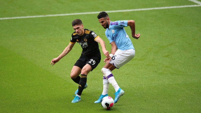 BATTLE : The lively Mahrez is pressurised by Vinagre.