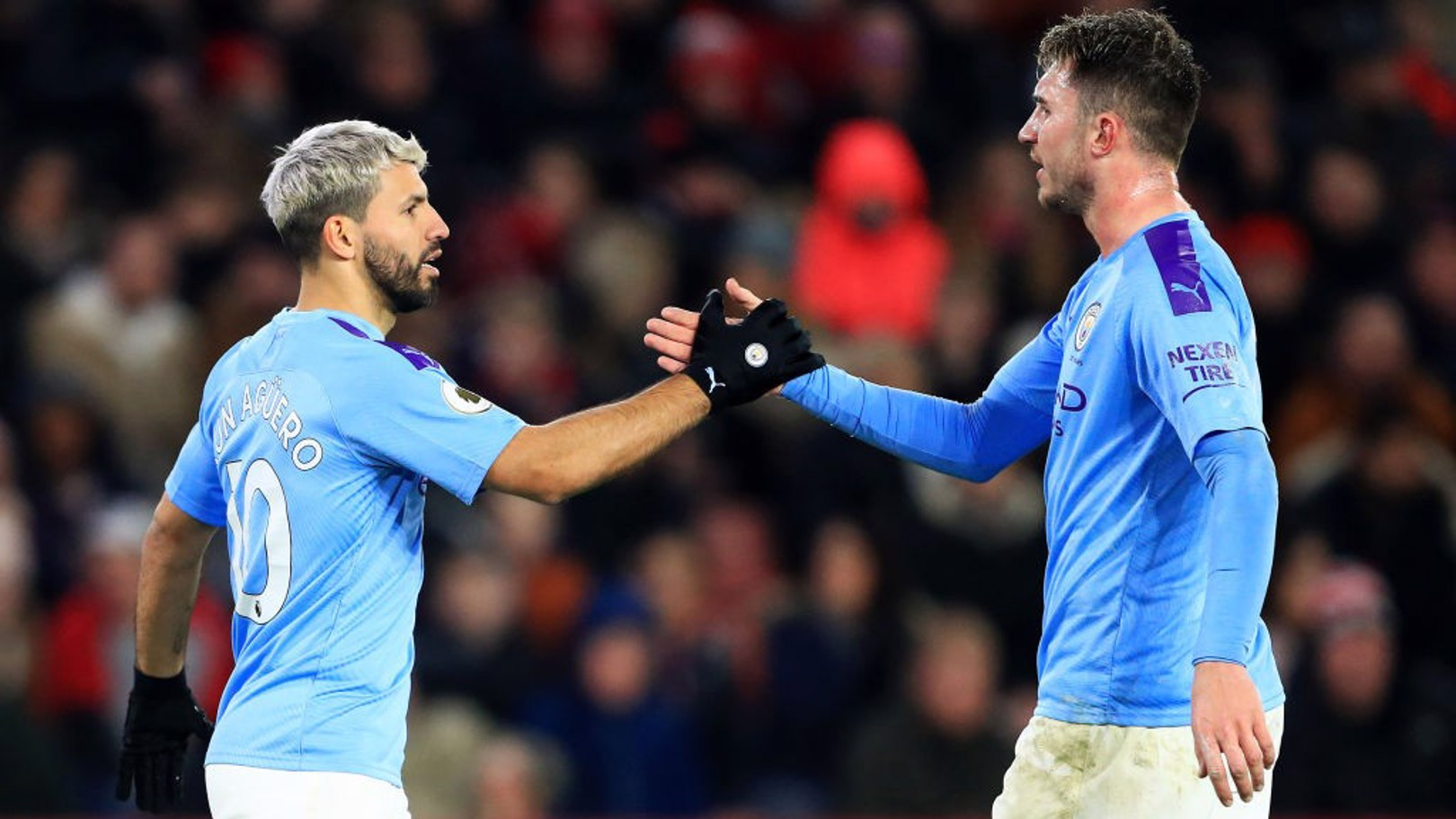 HIGH FIVE: Sergio Aguero celebrates with Aymeric Laporte.
