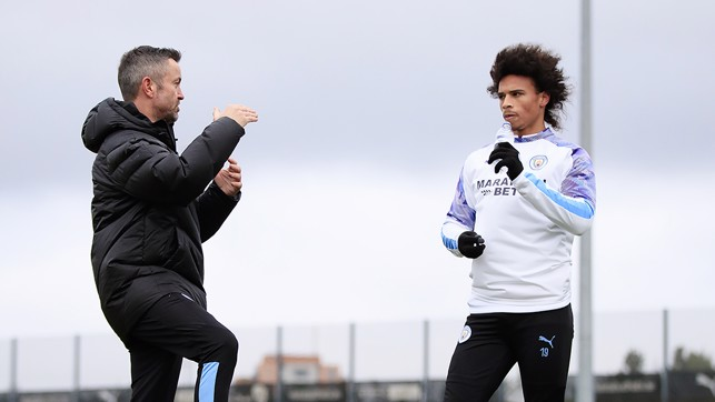 RECOVERY REPORT : Leroy gets advice during his latest session from Donough Holohan, City's sports science strength and conditioning coach
