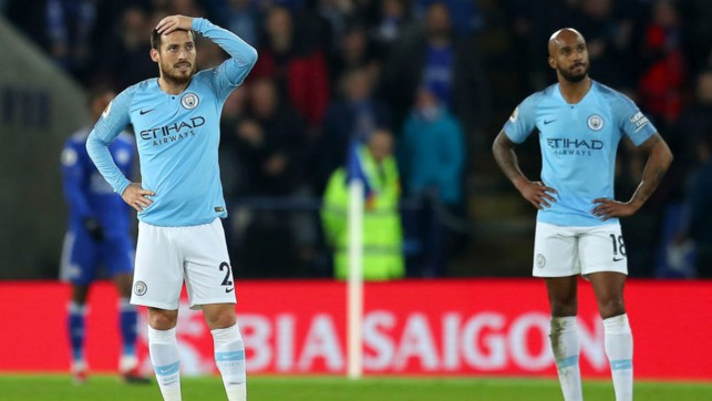 BOXING DAY BLUES : The expressions on the faces of David Silva and Fabian Delph sum up the day