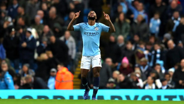BACK IN FRONT : Sterling celebrates after his close-range effort