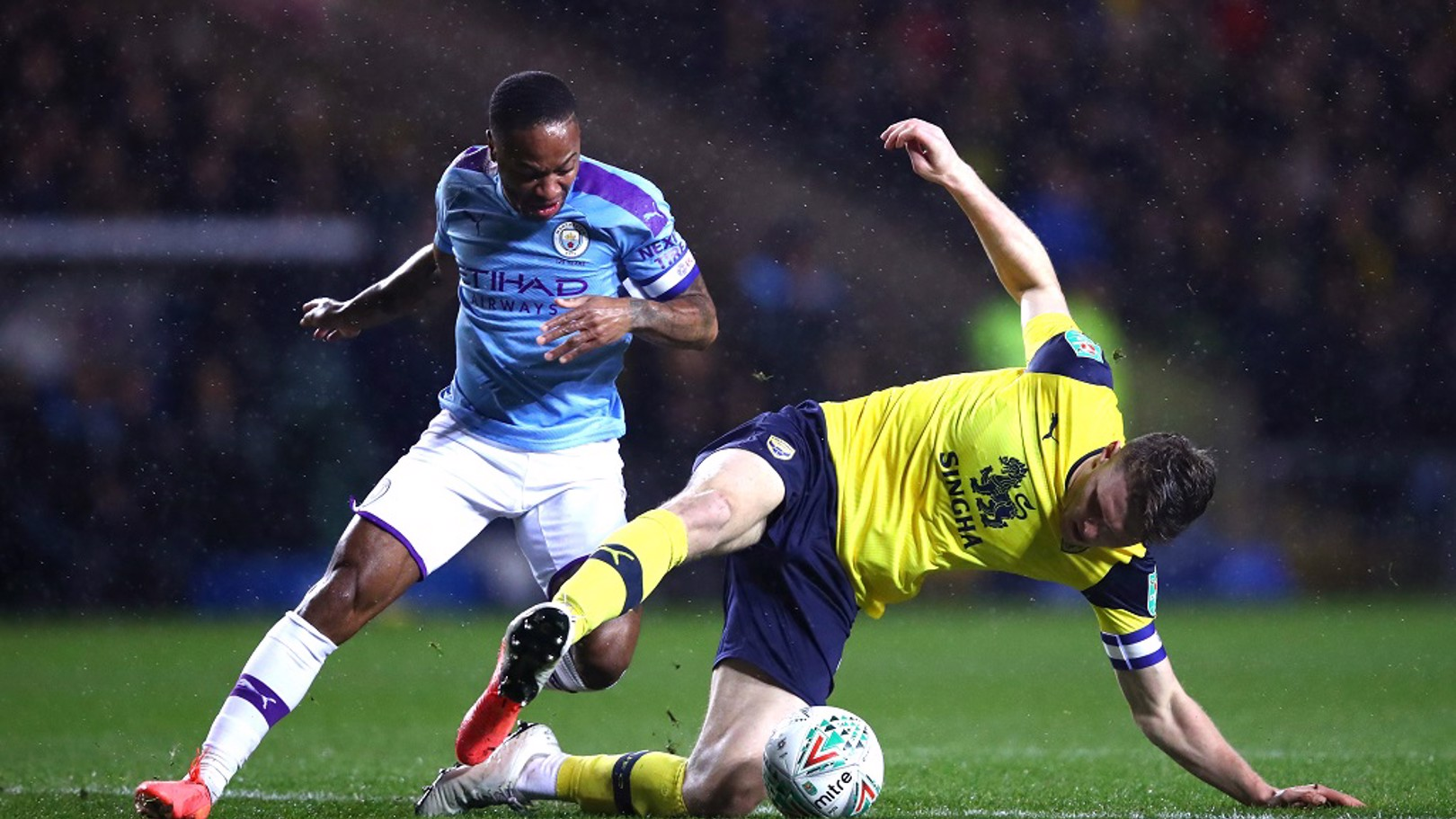 CHALLENGE: Oxford's Rob Dickie and Raheem Sterling