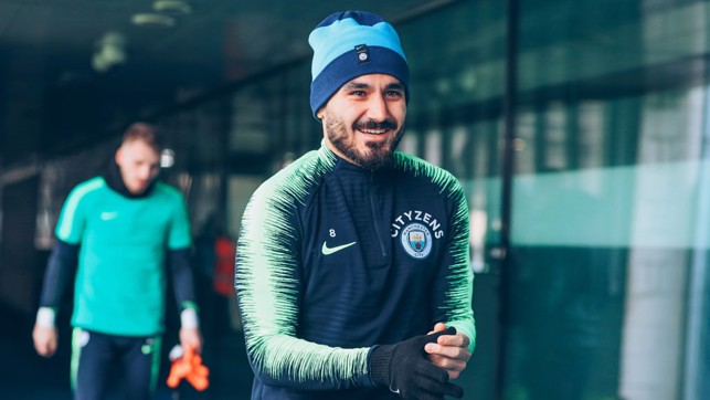 HAT TRICK : Ilkay Gundogan sports some nifty headwear to keep out the winter chill