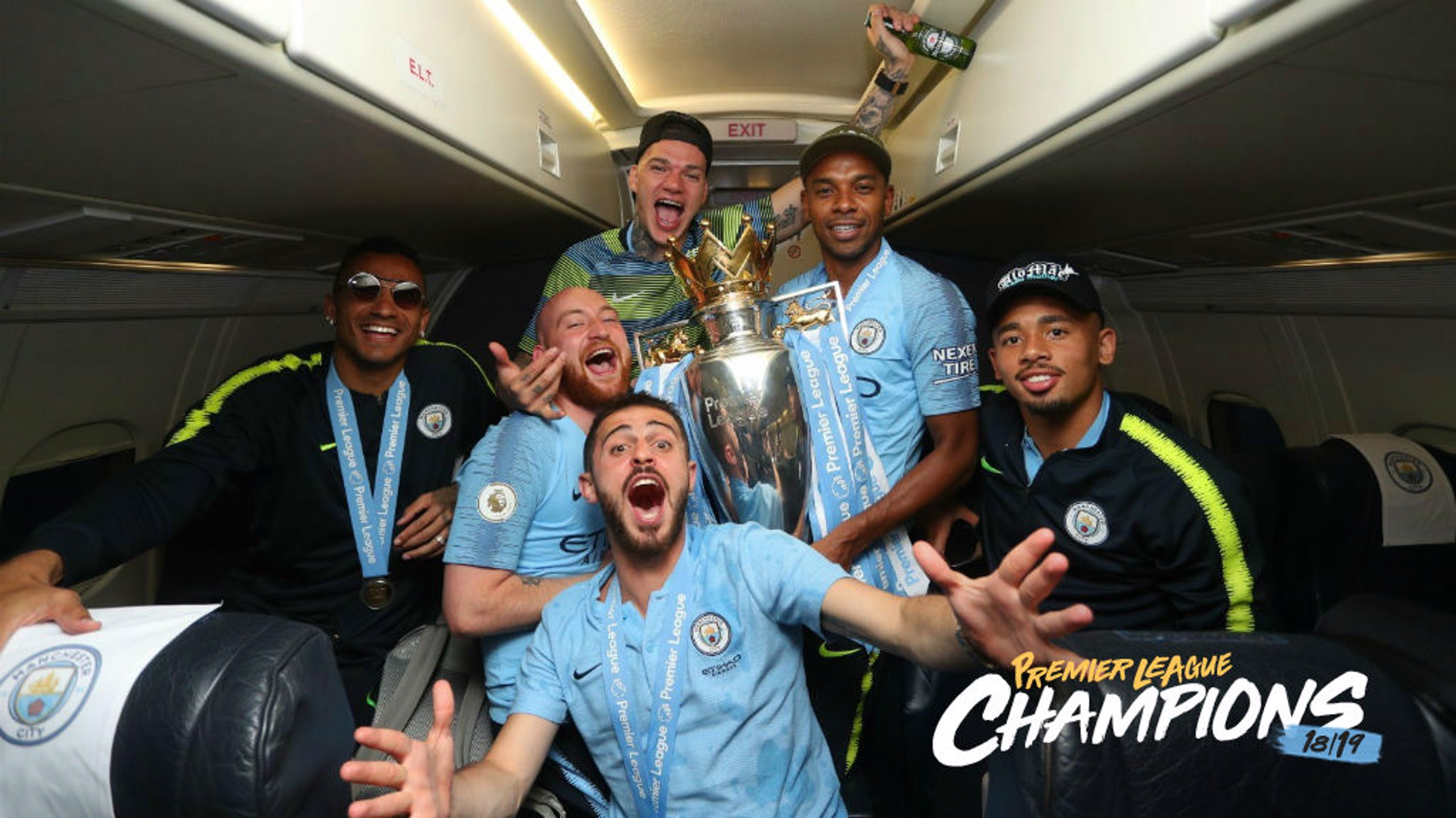 SOAR POINT: The City players celebrate their title success on the flight home from Brighton