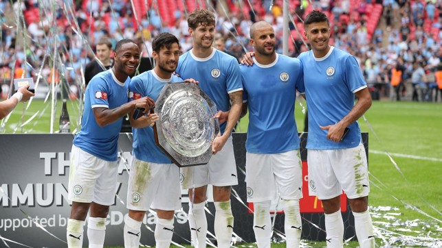 NEW ADDITION : City's stars pose for pictures with the newly-retained Community Shield.