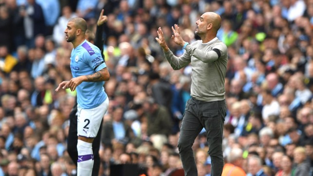 PEP WATCH : The manager issues instructions from the touchline.