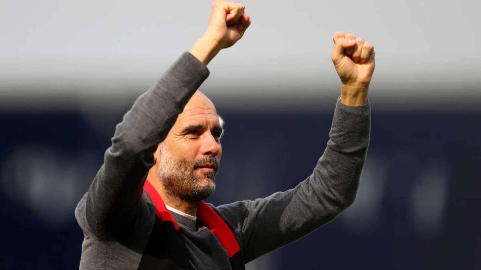 FITTING TRIBUTE: Pep Guardiola salutes the City fans wearing a red and black scarf in honour of Bernard Halford