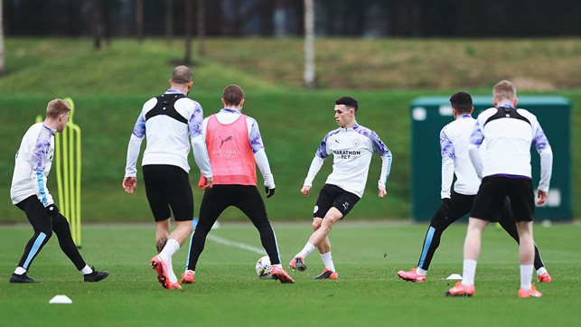 BEST FOOT FORWARD : Phil Foden and Co step up the tempo during a rondo session