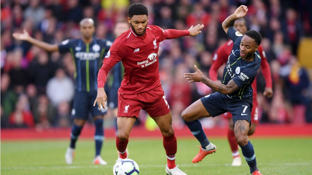 AT ARM'S LENGTH : Raheem Sterling looks to challenge Joe Gomez