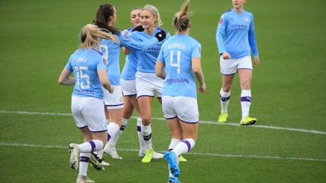 MOBBED: Steph Houghton celebrates after giving City an early lead against Brighton.