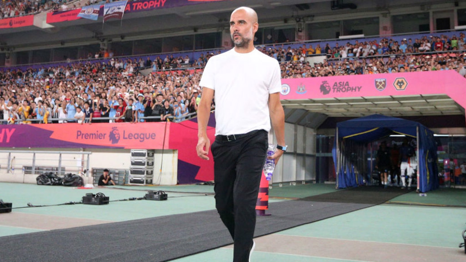 THE BOSS: Pep Guardiola watches on at the Nanjing Stadium