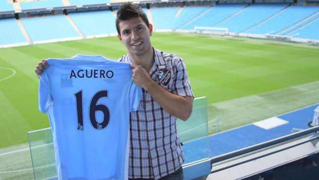 TRUE BLUE : Sergio Aguero proudly shows off his new City shirt after signing for the Club in the summer of 2011