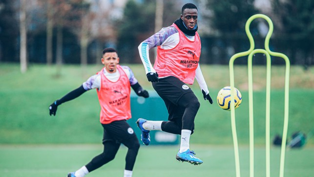 MEND IT LIKE BENJY : Ben Mendy leaps to meet the ball