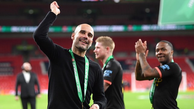 THE BOSS : Guardiola joins in the celebrations by appreciating the City fans.