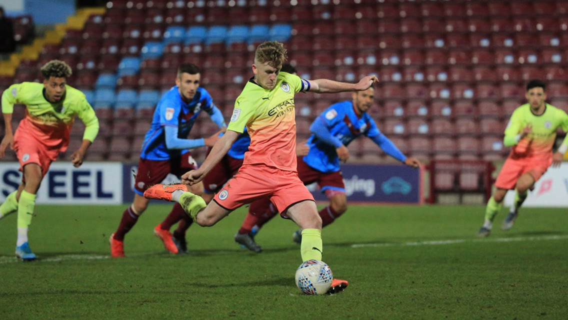 ON THE SPOT: Tommy Doyle fires home for City with a second half penalty