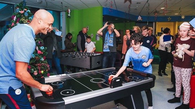 AIR HOCKEY : Our captain has a go at air hockey while on the Christmas hospital visit last year.