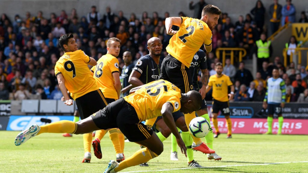 CONTROVERSIAL CALL : Willy Boly stoops to open the scoring for Wolves but replays showed the ball went in off his hand