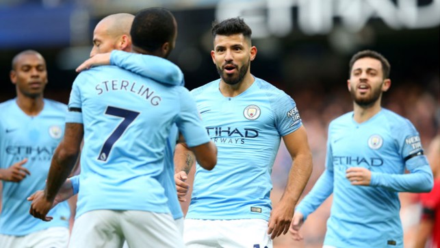 STARS ON SUNDAY : Sergio Aguero celebrates with his team-mates after scoring City's second goal