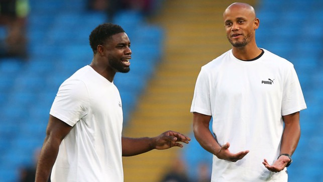OLD FRIENDS : Newly-retired Micah Richards warms up with Vincent Kompany before his Testimonial kicks off