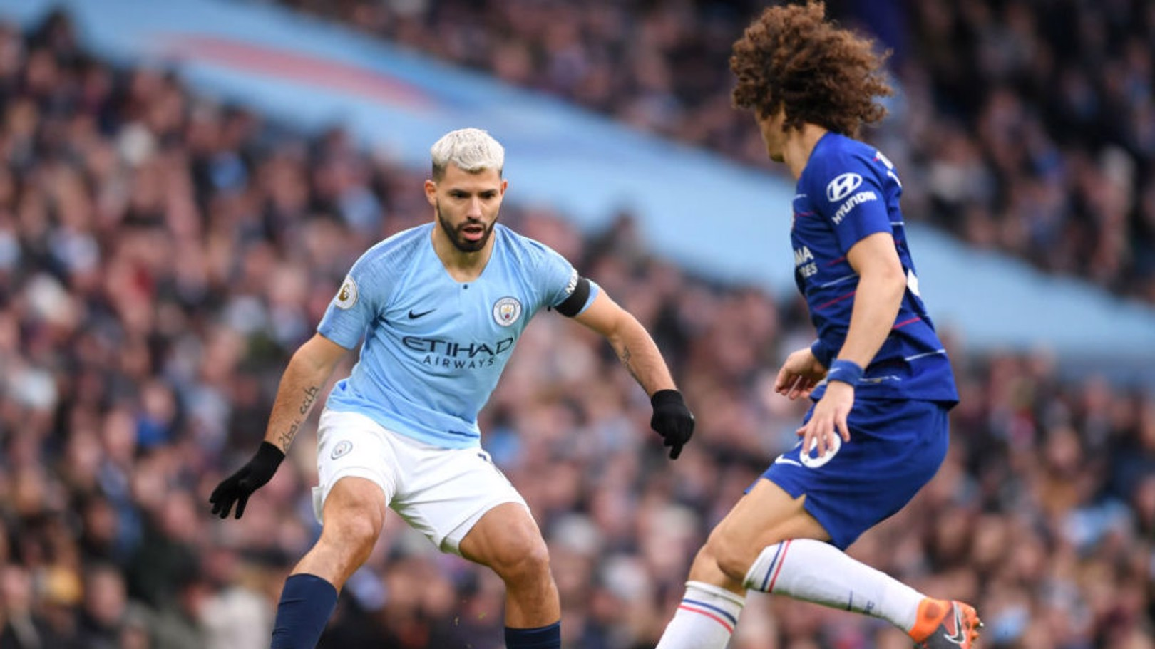 Sergio Aguero takes on David Luiz.