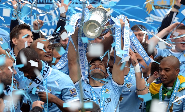 EYES ON THE PRIZE : Aguero looks up to the heavens after lifting the Premier League in 2014