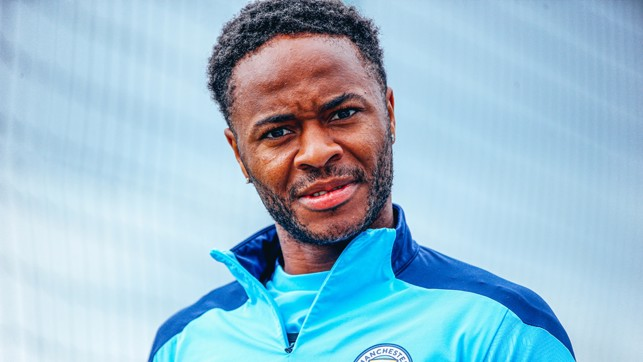 SPOTTED : Raheem Sterling plays up to the camera