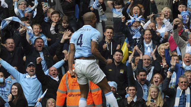 SQUAD LEADER : Kompany scores to help secure the Premier League title in 2014